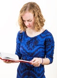 Slim Blonde Woman Reading a Book Royalty Free Stock Photography