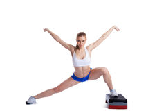 Slim blonde woman with stepper Stock Photo