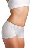 Slim Body. Closeup of a slim female body on a white background Stock Image