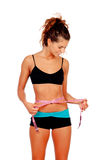 Slim brunette girl with tape measure and fitness clothes stock photography