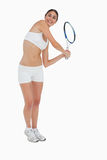 Slim brunette playing tennis in white clothes Stock Photo