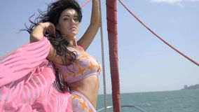 Free Slim Brunette With Flying Hair In A Swimsuit And Shawls On A Yacht. Luxury Lifestyle Stock Photo - 96683280