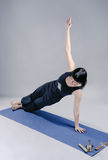 Slim brunette woman doing yoga Stock Photos