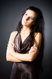 Slim brunette woman looking aside Stock Image