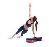 Slim brunette woman with stepper Stock Image