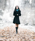 Slim brunette woman walking in a park Royalty Free Stock Images