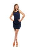 Slim cheerful girl in a short dress stock photo