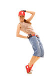 Slim dancer in red cap Stock Photography