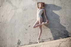 Slim dancer stands in a ballet pose Stock Photo