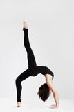 Slim dancer in yoga pose bending backwards royalty free stock image