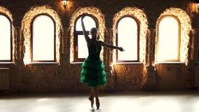 Slim elegant ballerina dancing on tip toes. Slow motion A ballerina balancing on her tiptoes in ballet studio. Training before performance stock video