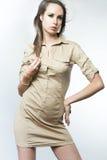 Slim fashion model posing on dark background. Royalty Free Stock Images
