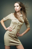 Slim fashion model posing on dark background. Royalty Free Stock Photos
