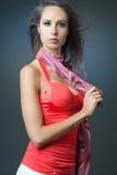 Slim fashion model posing on dark background. Royalty Free Stock Photo