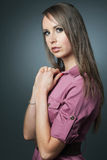 Slim fashion model posing on dark background. Royalty Free Stock Photography