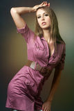 Slim fashion model posing on dark background. Stock Image