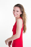 Slim fashion woman portrait with a red dress profile view Royalty Free Stock Photography