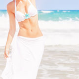 Slim female on the beach Royalty Free Stock Photography