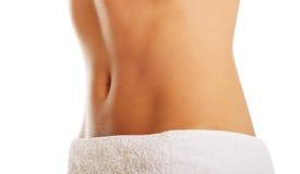 Slim female belly Stock Image