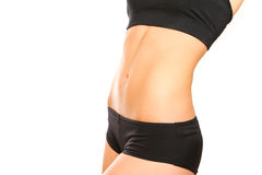 Slim female belly on white background Stock Photography