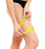 Slim female body with measure tape Stock Photo