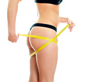 Slim female body with measure tape around hips. Royalty Free Stock Image