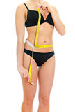 Slim female body with measure tape around waist. Stock Photo