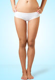 Slim female legs Stock Photography