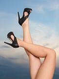 Slim female legs Stock Photography