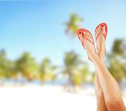 Slim female legs on sandy beach Stock Photography