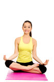 Slim female meditating in pose of lotus. Stock Photography