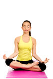 Slim female meditating in pose of lotus. Royalty Free Stock Photos