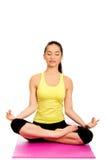 Slim female meditating in pose of lotus. Attractive young woman meditating in pose of lotus Royalty Free Stock Photos