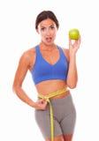 Slim female in sportswear taking waist measurement Stock Photos