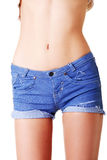Slim fit female's belly. Closeup. Royalty Free Stock Photos