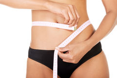Slim fit woman with measure tape Stock Photos