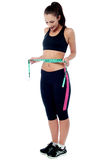 Slim fit woman measuring her waist Stock Images