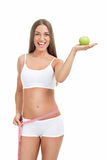 Slim and fit woman with measuring tape and apple Royalty Free Stock Photography