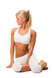 Slim fit woman resting ,after stretching exercise Stock Photos