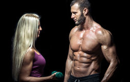 Slim fitness couple with dumbbells Royalty Free Stock Photography