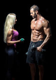 Slim fitness couple with dumbbells Stock Photography