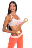Slim fitness girl holding a tennis ball Royalty Free Stock Photo