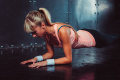 Slim fitness young woman Athlete girl doing plank Stock Image