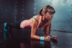 Slim fitness young woman Athlete girl doing plank exercise concept training workout crossfit gymnastics cross fit royalty free stock images