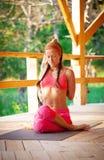 Slim flexible young girl doing yoga exercise Stock Photography