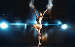 Slim fun caucasian ballerina posing on stage Royalty Free Stock Images