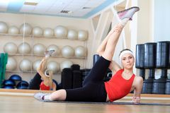 Slim girl. Young sporty woman in the gym centre Stock Image