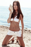 Slim girl in a bathing suit on the beach Royalty Free Stock Images