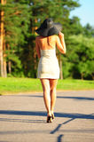 Slim girl in a beige dress Stock Photo
