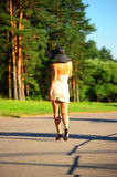 Slim girl in a beige dress Royalty Free Stock Image